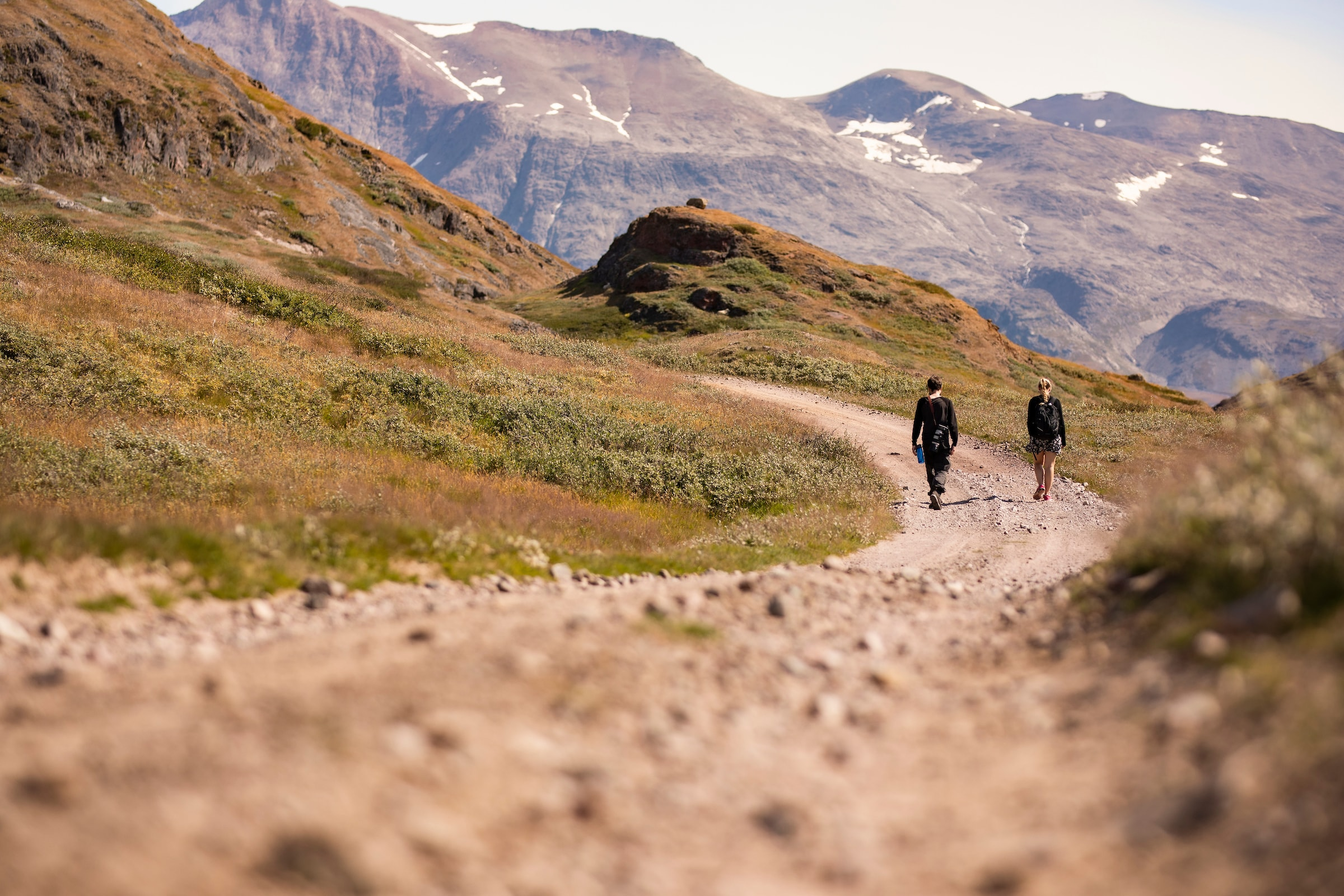 Walking in the land road in the summer in south Greenland. Photo by Aningaaq R Carlsen - Visit Greenland