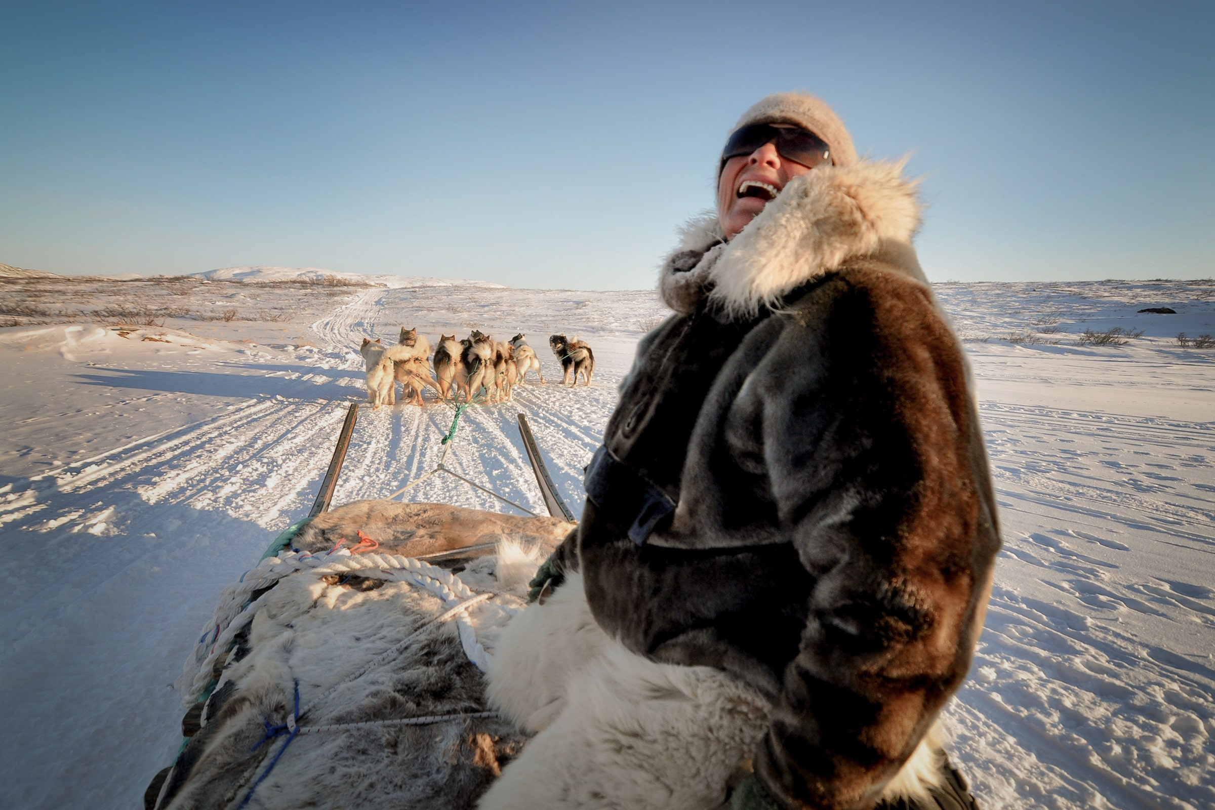 Dog sled driver and hunter Johanne Bech from Sisimiut on a dog sled trip near Kangerlussuaq in Greenland. Photo by Mads Pihl - Visit Greenland
